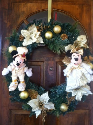 and it really shows my disney spirit i just attached the dolls by tying them on the wreath with some string and voila a custom disney wreath